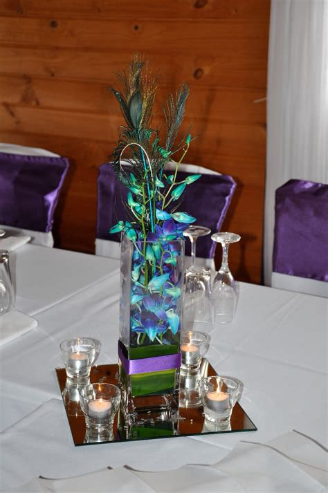 singapore orchid peacock feather wedding table