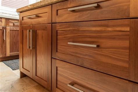 Wooden Kitchen Doors And Drawer Fronts Has A Stain Been Added To The Walnut Wood Cabinets If So What Color