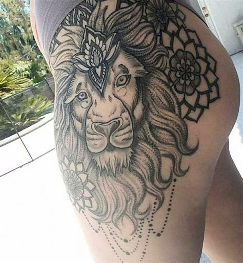 lion tattoo on thigh by garancheski tattoos