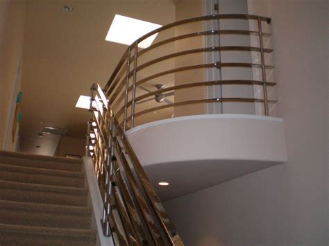 chrome banisters of stair with half wooden balusters and wrought iron pictures