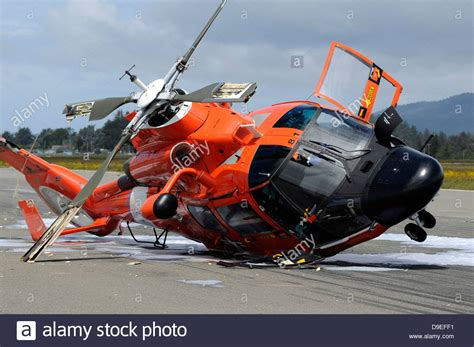 helicopter boat pictures miami a u s coast guard mh 65 dolphin helicopter lays on its
