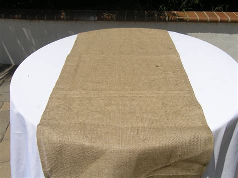 diy burlap table runner on wedding table with white