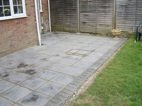 grey slab brick edged patio riverside home