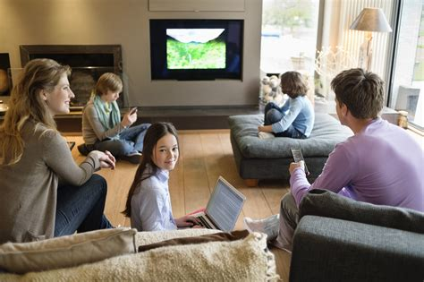 Family In Living Room | how young consumers multiscreen usage habits affect