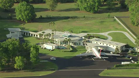 john travolta house ms aerial zo shot of john travolta house with airstrip in ground and neighboring