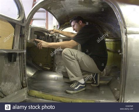 The Cole Background Check Cole Foster Checks The Fit Of A Re Shaped Dashboard Tuesday August Stock Photo