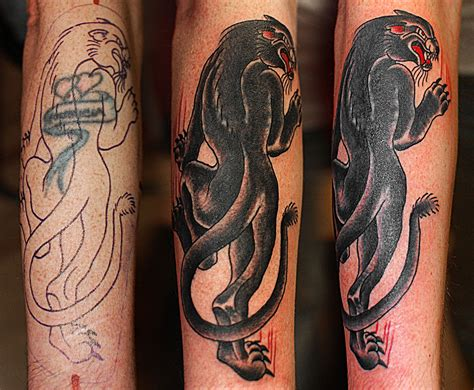 crawling panther tattoo coverup of a with a traditional crawling
