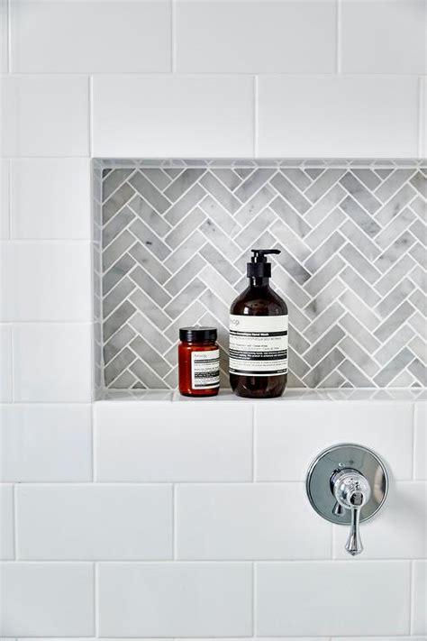 subway tile shower niches bathrooms pinterest white subway tiles frame a gray marble herringbone tiled