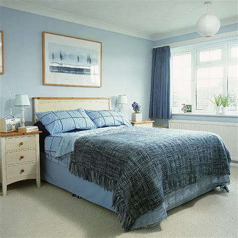 light blue bedroom furniture bedroom with blue walls and accessories and white