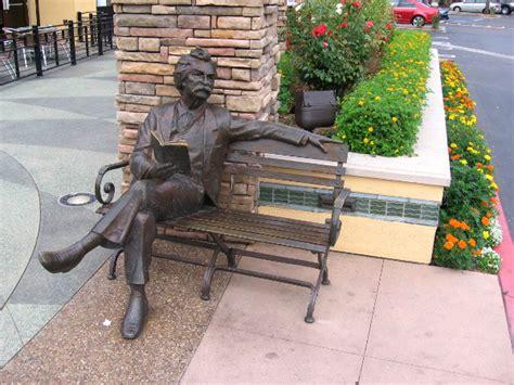 sculpture bench sculpture of mark twain reading book on bench cool san