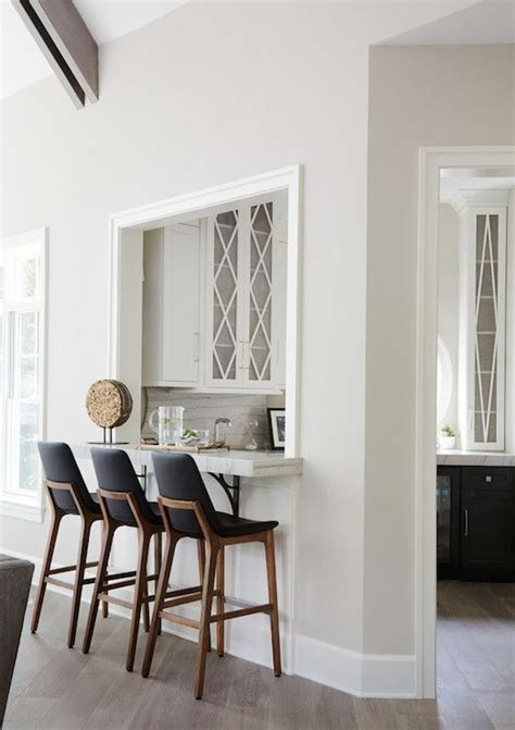 white kitchen cabinets with eclipse mullion k i t c h chic wet bar and butler s pantry combo features tuxedo