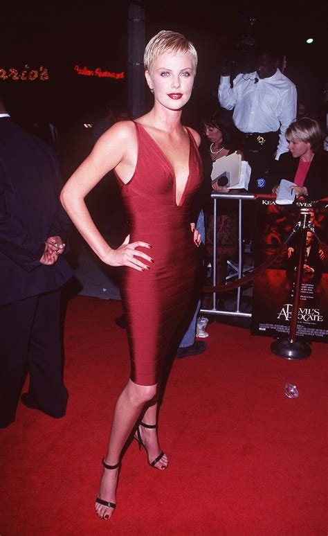 Festival Fashion Brangelina And Charlize Hit The Carpet In Venice And Deauville by Charlize Hit The October 1997 Premiere Of S Advocate