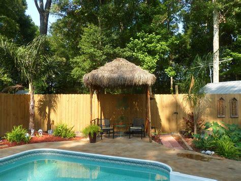 Hometalk   DIY Outdoor Tiki Hut using Repurposed Materials