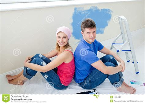 young couple room young couple painting a room during s break stock image image 14834621