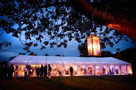 Interior Planner marquee lighting milling around a wedding marquee at dusk