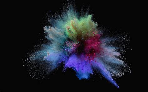 colorful sand explosion of colorful sand on black background hd