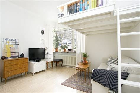 living in a small apartment small swedish studio apartment elegantly combines loft bed