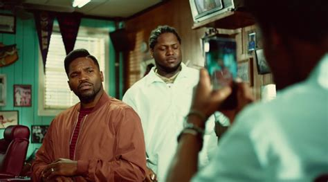 apples latest iphone   ad takes place   barbershop