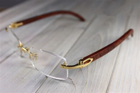 cartier c decor golden rimless eyeglasses engraved wood