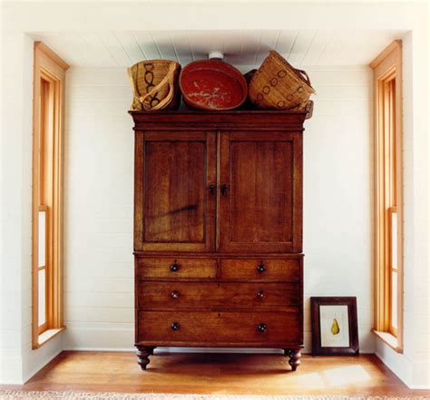 Top Of Armoire Decor by Designing Home Thoughts On Decorating The Top Of An Armoire