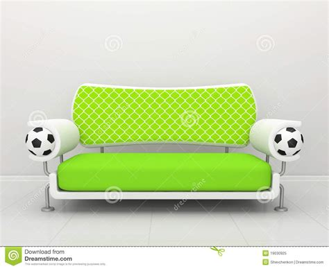Sofa Soccer green sofa with football symbolics royalty free stock