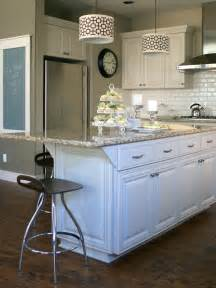 kitchen with white cabinets and island painting