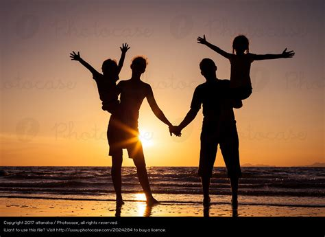 Family Nsun silhouette of happy family a royalty free stock photo