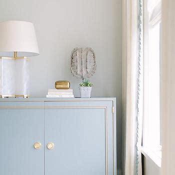 foyer quartz white cabinet with silver nailhead trim transitional