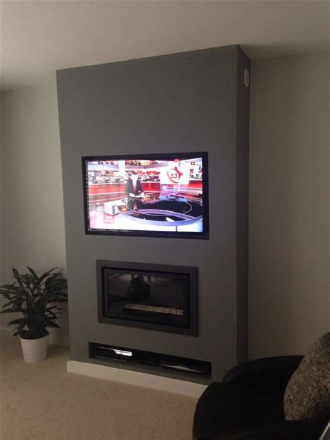 Hanging Tv Gas Fireplace by 25 Best Ideas About Tv On Wall On Tv On Wall