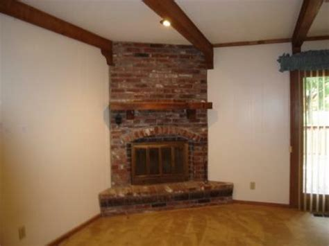Corner Brick Fireplace by 844 Nw 69th Terrace Kansas City Mo 64118 Sold