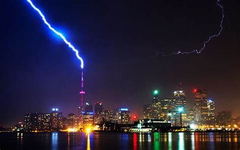 lightning strikes the cn tower during a thunderstorm in