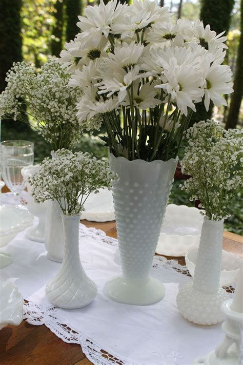 milk glasses vases in all sizes so with classic vintage rustic ret wedding
