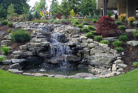 Landscape Ideas On Hillsides Hillside Landscaping With Rocks And Waterfall Front Yard