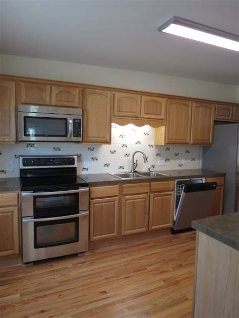 Updating Oak Kitchen Cabinets Before And After Jll Design How To Update Your Kitchen Without Breaking
