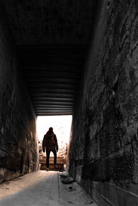Silhouette   Person Walking   Grey Floor Tiles