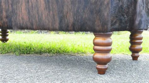 How To A Cowhide - cowhide ottoman upholstered in chocolate brown cow skin