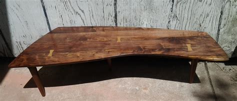 Walnut Sundra Style Table with Bowties