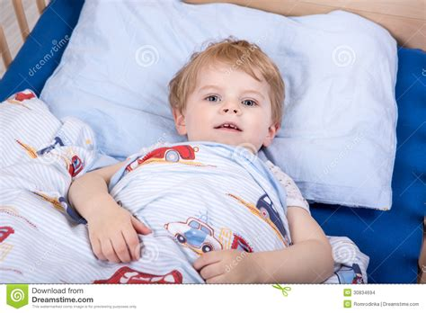 and boys in bed blond toddler boy in bed stock images image 30834694