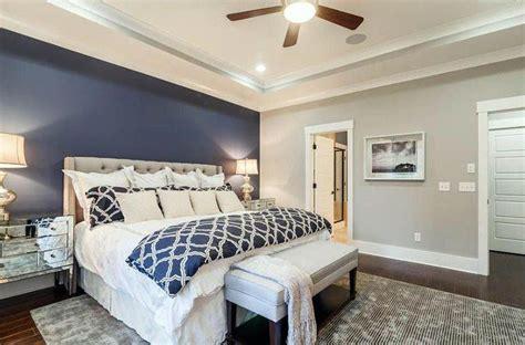 master bedroom  light gray walls  dark blue accent wall  tufted bed interior