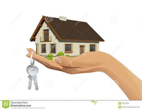 house making miniature house building on hand with keys stock