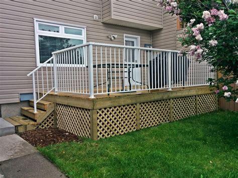 Deck Railing Designs With Lattice - calgary fence deck inc treated deck w enclosed