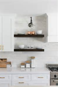 floating cabinets kitchen white shiplap vent hood with vintage leather counter
