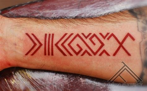 latin tattoo bicep red latin symbol forearm tattoo tattoos book 65 000