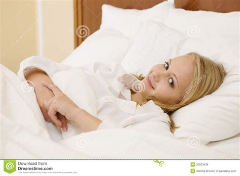 girl lying bed with flowers peaceful woman lying in bed resting at home royalty free