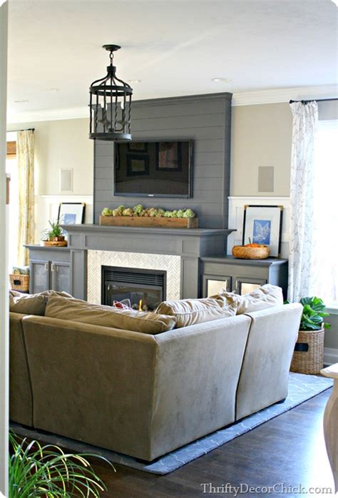 putting a tv a fireplace family room reveal from thrifty decor