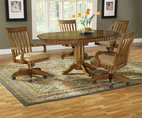 oak dining table with swivel rolling chairs free
