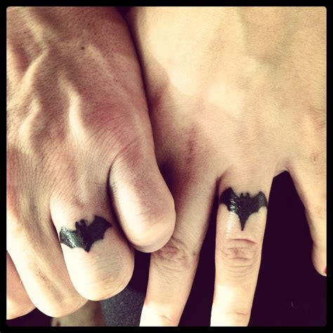 couples wedding ring tattoos batman batgirl wedding ring my husband and i
