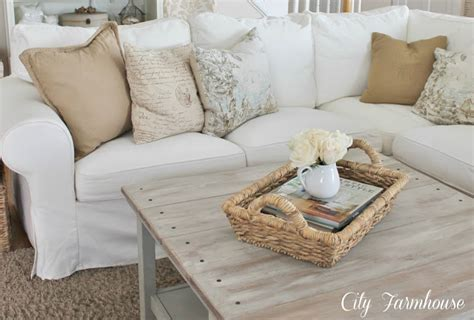 husse sofa ottomane real with a white slipcover keeping it pretty