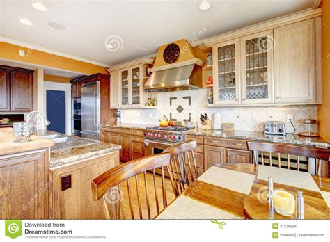 yellow and brown kitchen brown and yellow kitchen with dining table set stock