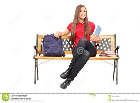 student bench smiling female student sitting on bench and holding a notebook stock photos image